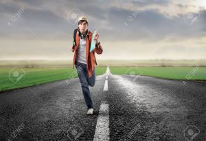6534908-Young-man-running-on-a-countryside-road-Stock-Photo-man-run-student